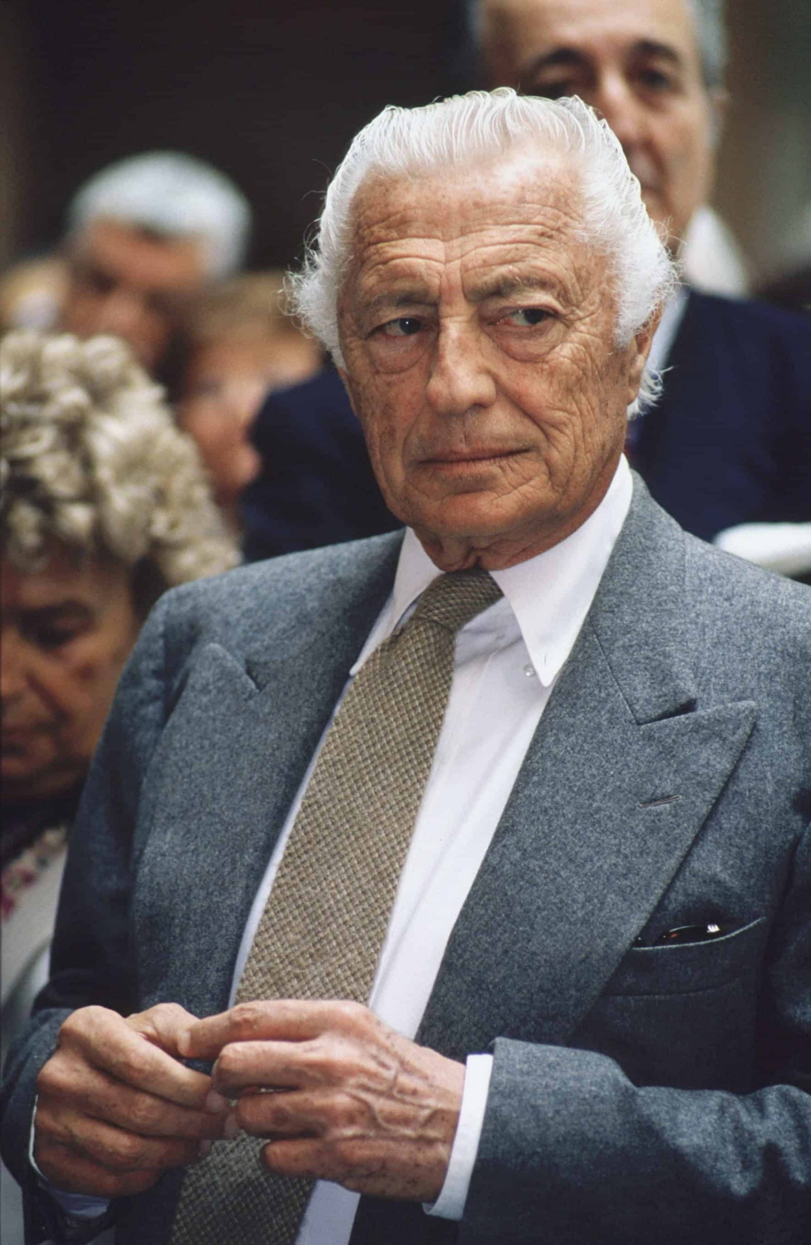 Gianni Agnelli in White OCBD Shirt and Grey Flannel Suit